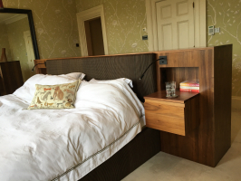 Bespoke furniture to place the bed in the centre of the room