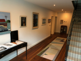Devon - A dark ground floor landing transformed into the perfect Art Gallery